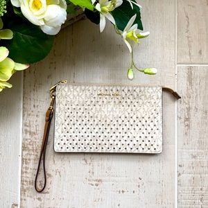 MICHAEL KORS Medium Gusset Wristlet with Perforated Gold Circles Like New